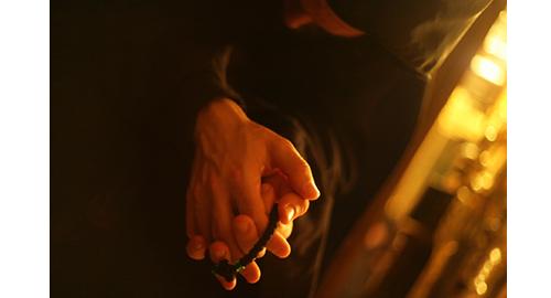 προσευχόμενος